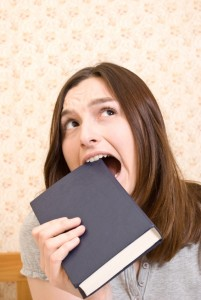 Young attractive woman with book
