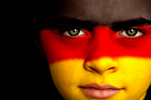 Portrait of a young German football / soccer fan, with the German Flag on his face.