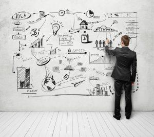 homme de dos écrit sur le mur une stratégie marketing - recrutement réussi